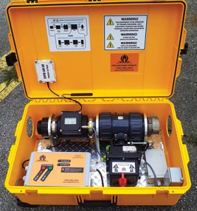"The ""WASP In A Box (WIAB)"" shows a flow meter, hydrant valve, and SkyWave terminal."